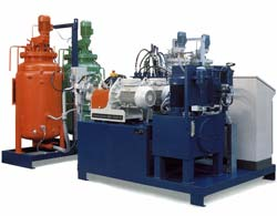 Shown here are two day tanks along with a urethane metering and dispensing unit. Click to enlarge.