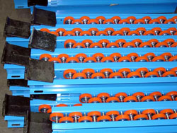 There are three types of Palletflo rails: entry, intermediate, and discharge. These are discharge rails with rail stops.
